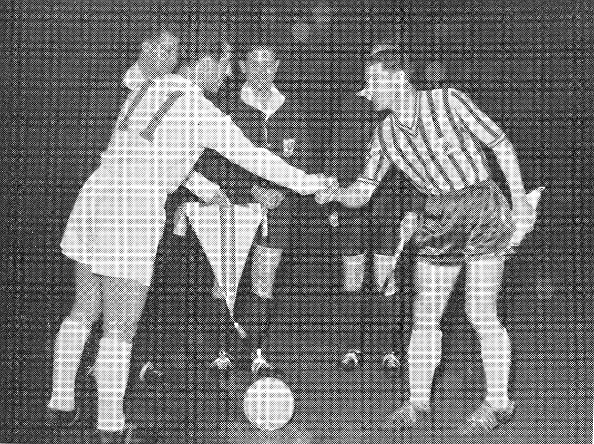 Francisco Ghento and Johnny McNichol shake hands before Real Madrid friendly.jpg